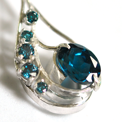 Detail of Blue Diamonds and Topaz Custom Pendant